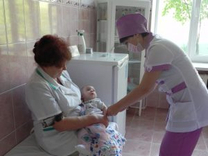 child is being vaccinated