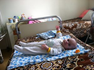 Alla on her bed at KCC
