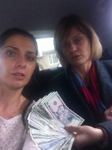 Vika gives donations to Olga's daughter Sasha, on the way to the train station