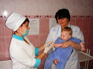 a child being vaccinated at NBH