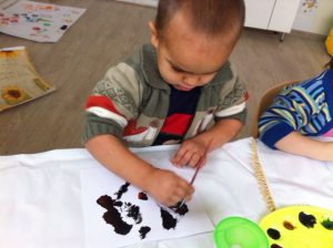 a child drawing with black