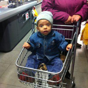 Yaroslav is shopping at the supermarket in Kiev